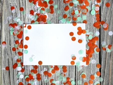 Tricolor paper confetti on a white wooden background. Irish, India and Chinu, independence day concept. patriotism and freedom, the joy of a national holiday. Mocup. copy space. space fo text. horizontal