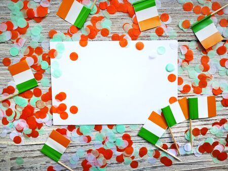 MARCH 17 Concept independence day of Ireland and Ireland national day.space for your text . mocup. mini flags on white wooden background with white paper sheets. horizontal Reklamní fotografie