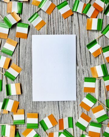 MARCH 17 Concept independence day of Ireland and Ireland national day.space for your text . mocup. mini tick boxes with a sheet of white paper on a white wooden background . vertical