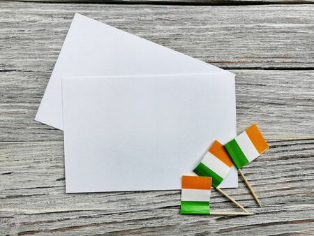 MARCH 17 Concept independence day of Ireland and Ireland national day.space for your text . mocup. mini flags on white wooden background with white paper sheets. horizontal Stockfoto