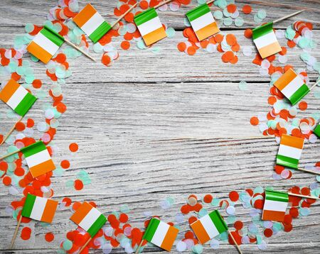 MARCH 17 Concept independence day of Ireland and Ireland national day.space for your text . mini flags on white wooden background , horizontal Stockfoto