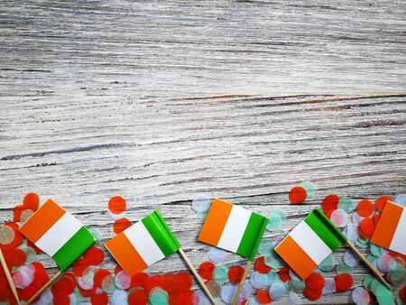 MARCH 17 Concept independence day of Ireland and Ireland national day.space for your text . mini flags on white wooden background with confetti. Stockfoto