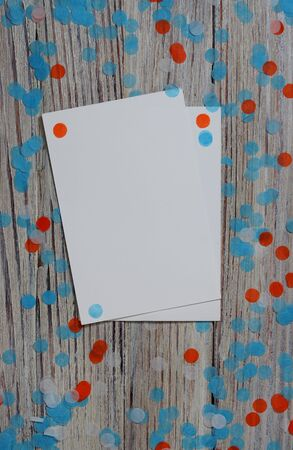 July 9. Independence day of Argentina, Sweden concept of the Day of memory, freedom and patriotism. paper confetti and sheets of white paper on a wooden white background.