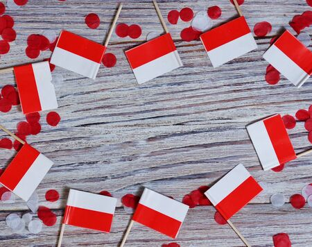 Happy Independence Day Poland flag and wood background Banco de Imagens - 128259091