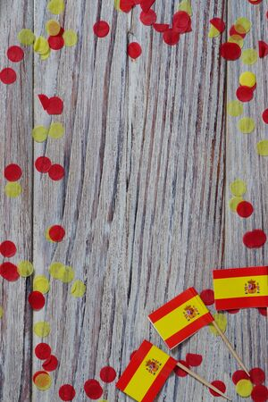 Independence Day of Spain concept with flag in hand on white wooden background top view Banco de Imagens - 128259141
