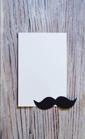 white paper envelop on old wooden table with vintage tone. black paper mustache. Happy father's day - words. Banco de Imagens - 128259208