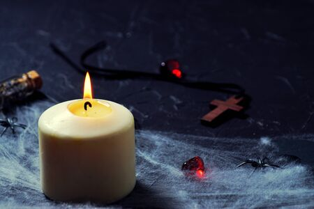 Wooden cross, old runes, pentagram and black candles. Mystic background with ritual esoteric objects, occult and halloween concept Standard-Bild