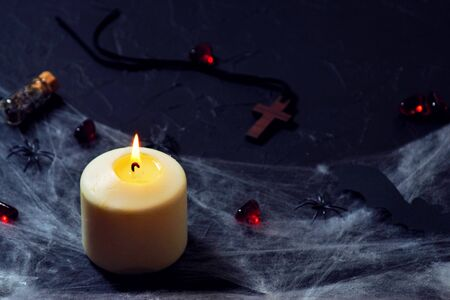 Wooden cross, old runes, pentagram and black candles. Mystic background with ritual esoteric objects, occult and halloween concept Banco de Imagens - 128259330
