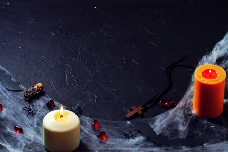 Wooden cross, old runes, pentagram and black candles. Mystic background with ritual esoteric objects, occult and halloween concept Banco de Imagens