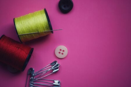 threads and needles on the background with patterns, accessories for cutting and sewing, womens hobby, tailoring