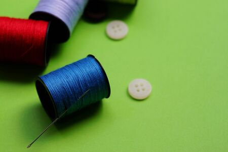 threads and needles on the background with patterns, accessories for cutting and sewing, womens hobby Banco de Imagens