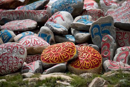 tibetian: Stone with tibetian mantras Tibet sanscrit