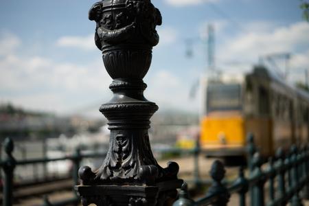 Yellow tram near Chain bridge in Budapest