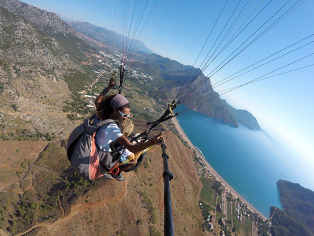 parachute jump: ADRASAN, TURKEY - JUNE 27, 2017: Paraglaiding fly above laguna