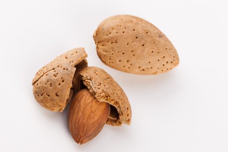 Whole almonds nuts isolated on white background