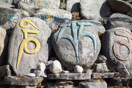 Stone with tibetian mantras Tibet sanscrit
