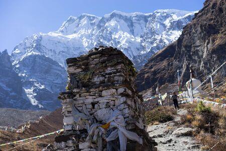 Buddhist stupa and lungta prayer flags in the Himalaya mountains, Annapurna region, Nepal Stock Photo