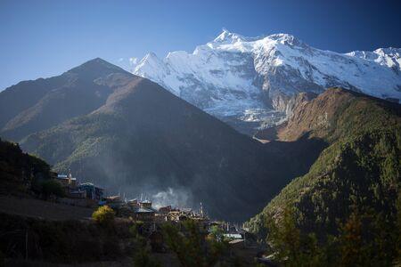 Buddhist gompa and prayer flags in the Himalaya range, Annapurna region, Nepal Stock Photo