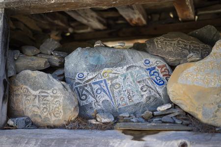 Stone with tibetian mantras Tibet sanscrit Stock fotó - 90328263
