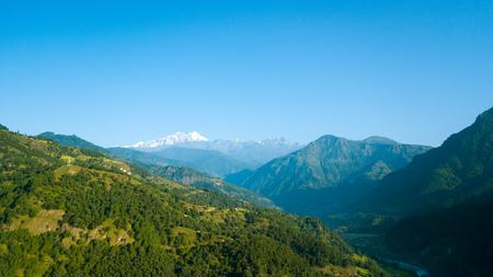 Sunrise above peak in the Himalaya range, Nepal