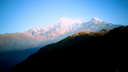Annapurna area Orange sunrise above mountain in valley Himalayas mountains Stock Photo
