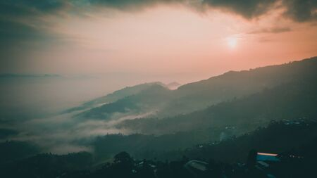 Sunset above mountain in valley Himalayas mountains Фото со стока