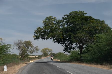 Road with bike summer time in Kerala India