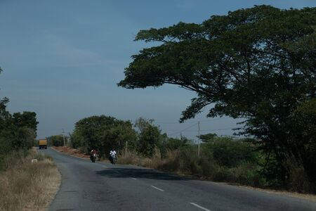 Road with car summer time in Kerala India