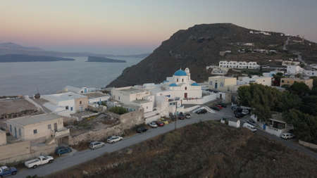 Aerial view flying small town on Santorini Greece