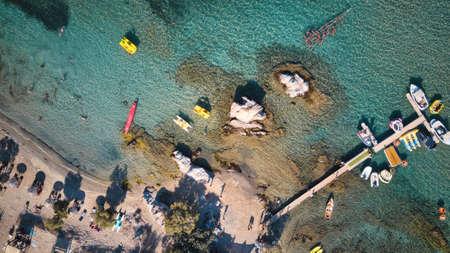Aerial drone of sandy beach sea water Paros island Cyclades, Greece
