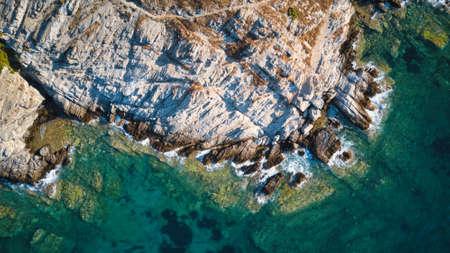 Aerial top view of sea waves break on a beach. drone shot Greece Zdjęcie Seryjne