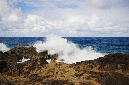 Waves breaking on the rocks. Beautiful seascape. photo