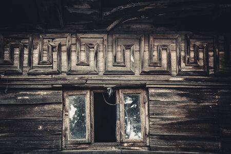 attic window: attic window in an old wooden house, ornament meander