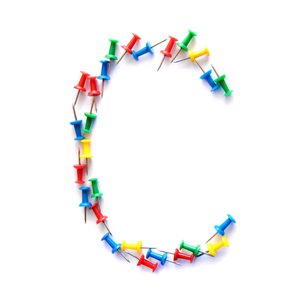 Letter C English alphabet from multicolored stationery office buttons, isolate on white background