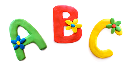 Plasticine multicolored letters A B C, English alphabet, isolate on white background