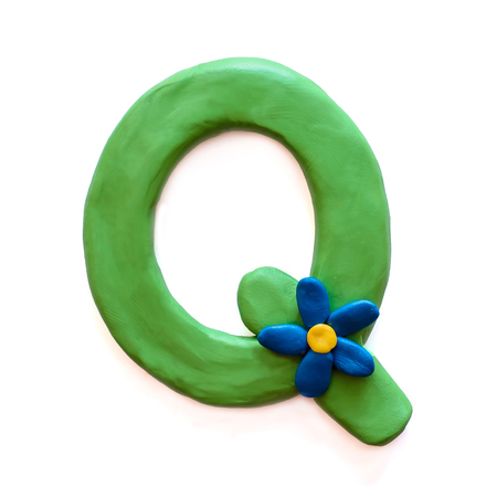 Green plasticine letter M English alphabet with blue flower, isolate on white background