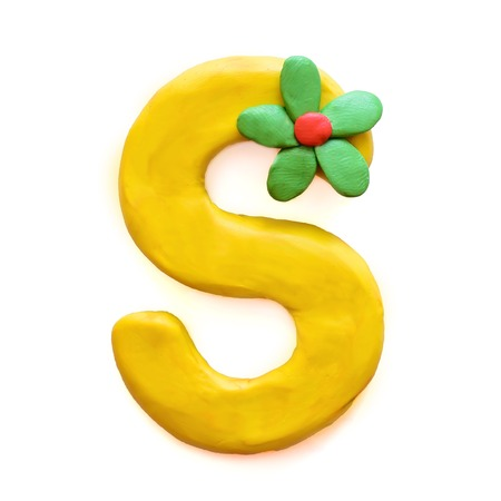 Yellow plasticine letter S English alphabet with green flower, isolate on white background