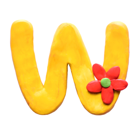Yellow plasticine letter W of English alphabet with red flower, isolate on white background
