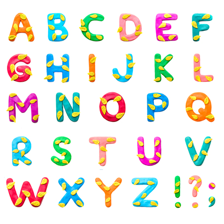 Plasticine colored English alphabet A-Z on the autumn theme with yellow leaves , punctuation marks, isolate on white background