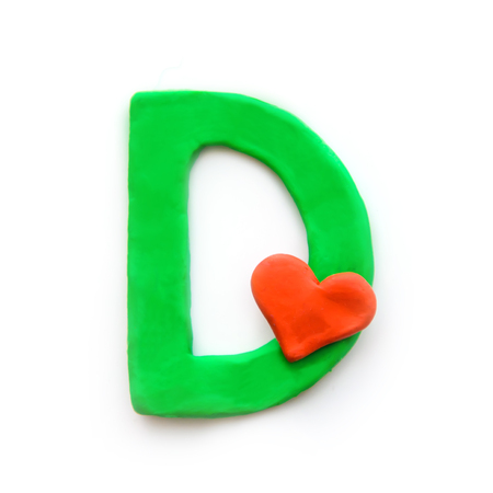 Green plasticine letter D English alphabet with red heart meaning love on Valentine's day, isolate on white background