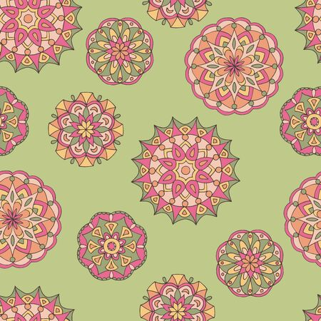 Abstract seamless pattern of hand-drawn mandalas in beautiful colors on green background Standard-Bild - 127662674