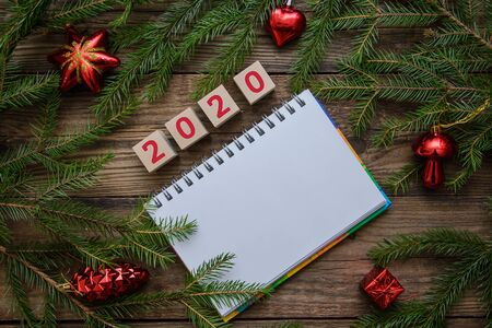 Christmas wooden background with warm tea mug, Notepad, scarf, toys for 2020 new year, holiday card Stok Fotoğraf