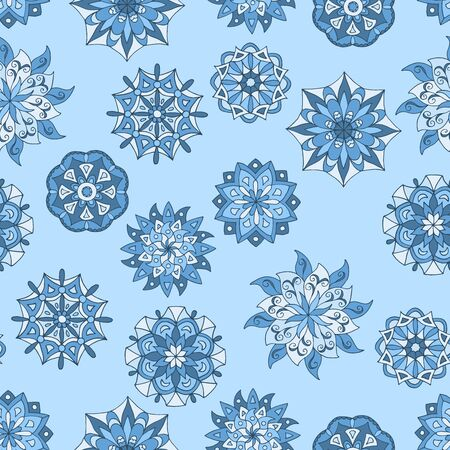 Beautiful seamless pattern with winter mandalas on blue background