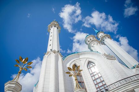 Russia, Kazan, August 24, 2019: view of the Kul Sharif mosque on a sunny summer day, minarets against the blue sky