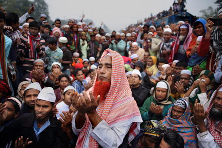 Muslims join at the first phase of Bishaw Ijtema, which concludes with the Akheri Munajat final prayers seeking world peace. It is the 2nd largest congregation of the Muslims after Holy Hajj. Tongi, Bangladesh.