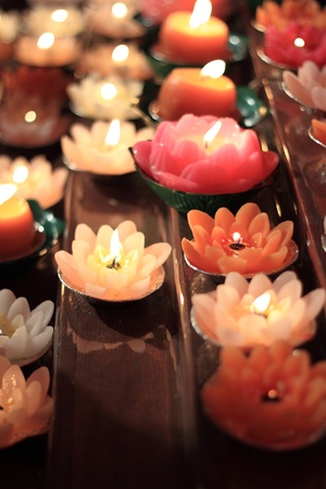 devoted: The lotus candles at the temple during chinese new year festival Stock Photo