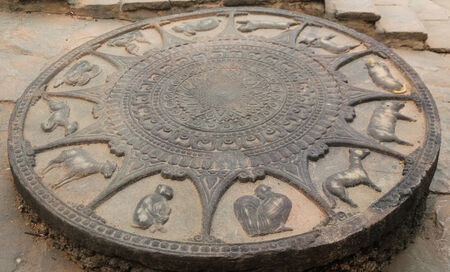 Cement zodiac at temple vintage object photo