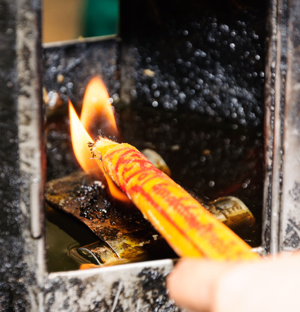 light a magic candle at temple photo