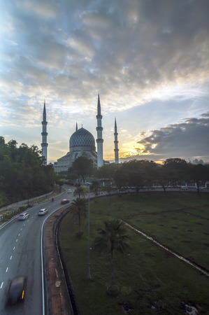 shah: The beautiful Sultan Salahuddin Abdul Aziz Shah Mosque (also known as the Blue Mosque) located at Shah Alam, Selangor, Malaysia during sunrise with long exposure. Stock Photo