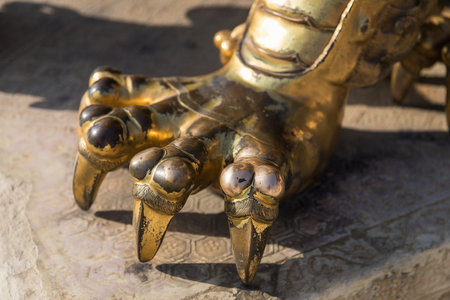 Chinese traditional style copper lion paw closeup